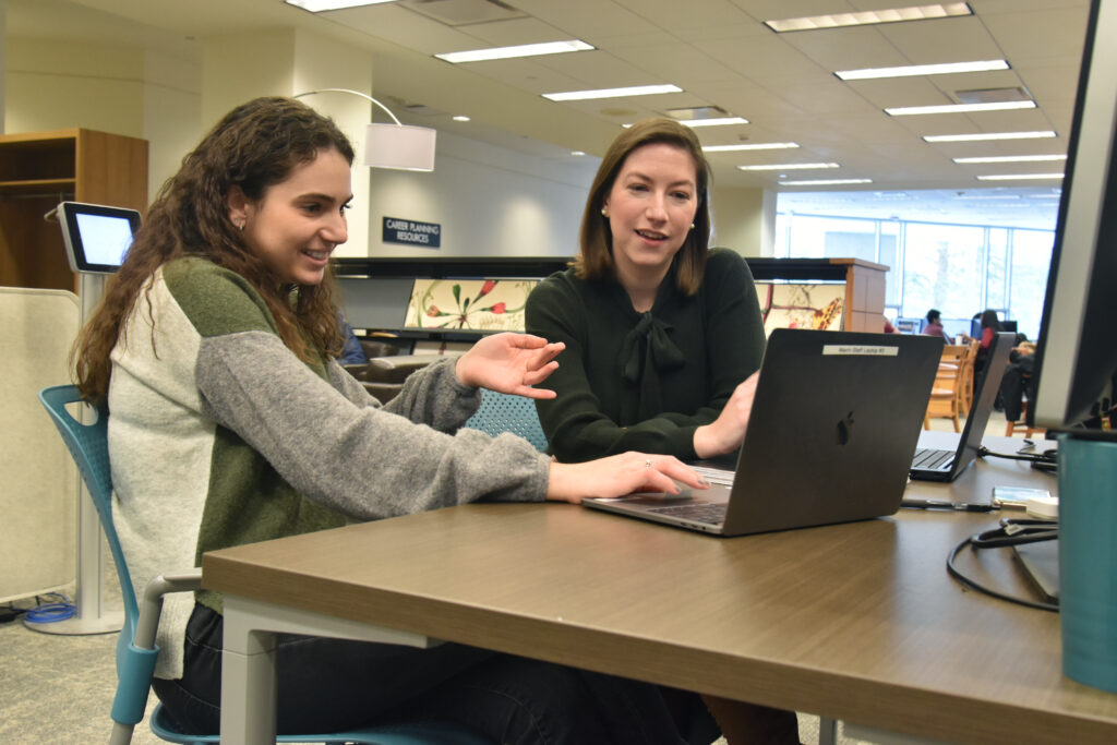 Image of Mann Librarian working with student