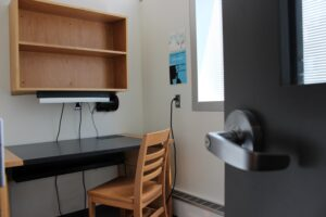 Individual study room with desk and chair