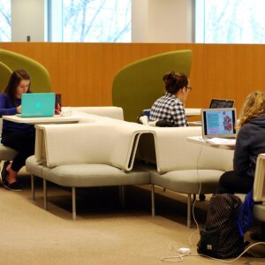Students studying with laptops on soft seating