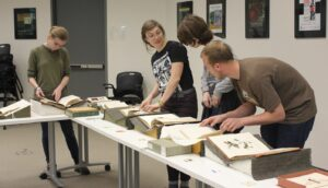 Students viewing special collections items