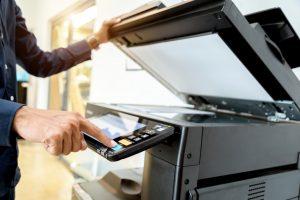 Man using copier/scanner